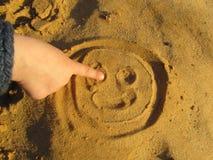 Glimlach in het zand Stock Foto