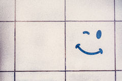 Glimlach op keramische tegel Royalty-vrije Stock Afbeelding