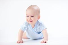 Glimlachbaby in blauw Stock Foto's