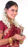 Glimlachend Aziatisch meisje met de lamp Royalty-vrije Stock Fotografie