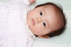 Glimlachend babymeisje Royalty-vrije Stock Afbeeldingen