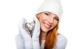 Glimlachend de valentijnskaarthart van de meisjesholding Stock Foto