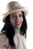Glimlachend doordrongen meisje met een hoed Stock Foto