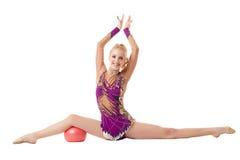 Glimlachend flexibel meisje die spleet doen Royalty-vrije Stock Foto