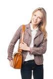 Glimlachend jong mooi meisje die zich met zak bevinden Royalty-vrije Stock Afbeeldingen