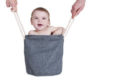 Glimlachend kind in een zak Royalty-vrije Stock Afbeelding