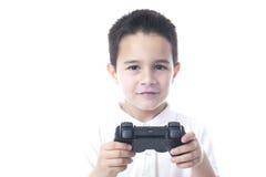 Glimlachend Kind met spelcontrolemechanisme in hun handen. Stock Afbeelding