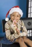 Glimlachend kind in santahoed royalty-vrije stock fotografie