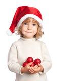 Glimlachend meisje in de hoed van de Kerstman met decoratie stock foto