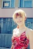Glimlachend meisje met blauwe ogen Royalty-vrije Stock Afbeeldingen