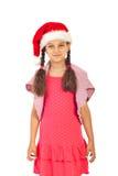 Glimlachend meisje met de hoed van de Kerstman royalty-vrije stock afbeelding
