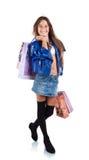 Glimlachend meisje met document zakken voor het winkelen Royalty-vrije Stock Afbeeldingen