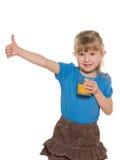 Glimlachend meisje met een glas jus d'orange Royalty-vrije Stock Afbeelding