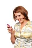 Glimlachend meisje met een mobiele telefoon royalty-vrije stock afbeelding