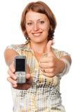 Glimlachend meisje met een mobiele telefoon Stock Foto's