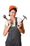 Glimlachend meisje met hamer en moersleutel Royalty-vrije Stock Afbeelding