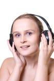 Glimlachend meisje met hoofdtelefoons Stock Fotografie