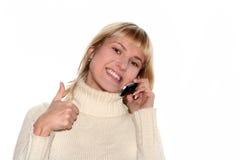 Glimlachend meisje met mobiele telefoon stock foto's