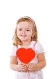 Glimlachend meisje met rood hart Royalty-vrije Stock Foto's