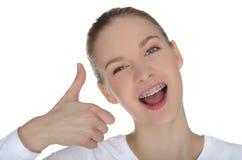 Glimlachend meisje met steunen Stock Foto