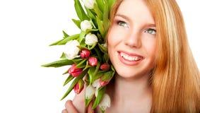 Glimlachend meisje met tulpenboeket op witte backgrou Royalty-vrije Stock Fotografie