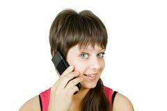 Glimlachend mooi meisje met een telefoon Stock Foto's