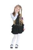 Glimlachend mooi meisje op het wit Royalty-vrije Stock Afbeeldingen