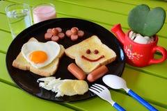 Glimlachend ontbijt Stock Foto's