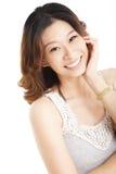 Glimlachende Aziatische jonge vrouw Stock Foto's