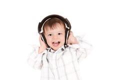 Glimlachende baby met hoofdtelefoons Stock Afbeelding