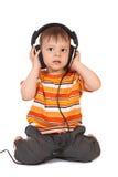Glimlachende baby met hoofdtelefoons Royalty-vrije Stock Afbeeldingen