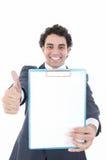 Glimlachende bedrijfsmens in kostuum die een banner of nota's opnieuw steunen Stock Afbeelding