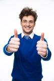 Glimlachende bedrijfsmens met omhoog duimen Stock Foto's