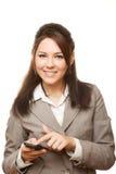Glimlachende bedrijfsvrouw met mobiele telefoon stock foto