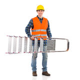 Glimlachende bouwvakker met ladder. stock afbeeldingen