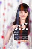 Glimlachende bruid met kleppenraad stock foto