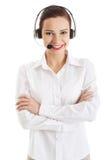 Glimlachende call centrevrouw met gevouwen wapens Royalty-vrije Stock Fotografie