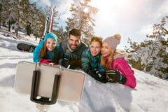 Glimlachende familie die pret hebben - Mobiele foto Selfie Royalty-vrije Stock Afbeelding