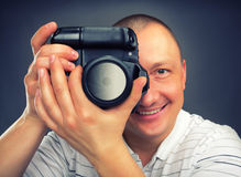 Glimlachende fotograaf Royalty-vrije Stock Afbeeldingen
