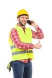 Glimlachende handarbeider op de telefoon Royalty-vrije Stock Fotografie