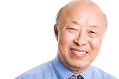 Glimlachende hogere Aziatische zakenman royalty-vrije stock afbeelding
