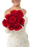Glimlachende jonge bruid die een roze boeket standhouden Royalty-vrije Stock Foto's