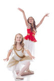 Glimlachende jonge die ballerina's, op wit worden geïsoleerd Stock Foto