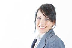 Glimlachende jonge vrouw in een kostuum Royalty-vrije Stock Afbeeldingen