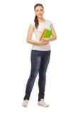 Glimlachende jonge vrouw met boeken Stock Afbeelding