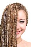 Glimlachende jonge vrouw met dreadlocks Royalty-vrije Stock Afbeeldingen