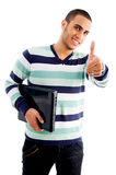 Glimlachende jongen met omhoog laptop en duimen Royalty-vrije Stock Afbeelding