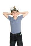 Glimlachende jongen met opgeheven wapens Royalty-vrije Stock Foto's