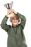 Glimlachende kampioen met zijn trofee Stock Foto