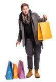 Glimlachende knappe mens met het winkelen zakken Stock Afbeeldingen